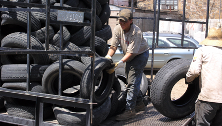 Unloading waste tires at a processing plant