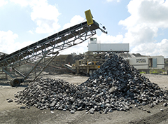 Stockpiling crushed rock at a quarry