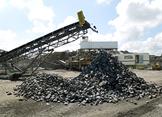 Conveyor transporting crushed rock