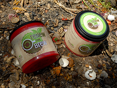 Repurposed coffee cans serve as coffee grind collection containers for back yard composting program